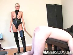 Mistress Autumn in thigh high black boots dominates male
