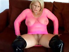 Busty mature in bodystocking & boots flashing pussy