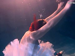 bulava lozhkova with a red tie and skirt underwater